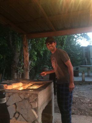 John preparing the grill